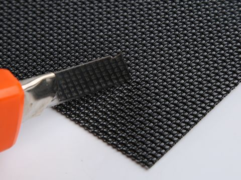 There is an aerometal mesh sheet with a knife on it.