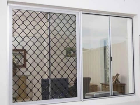 There is black aluminum grille screen installed on window frame.