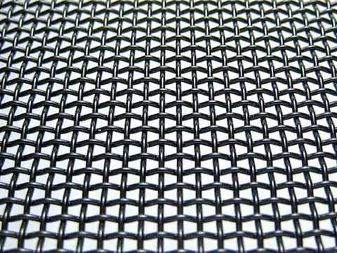 A piece of galvanized security mesh with black powder coated