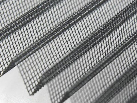 There is a fiberglass plisse mesh sheet.