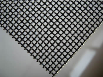 A piece of security screen on the gray background.