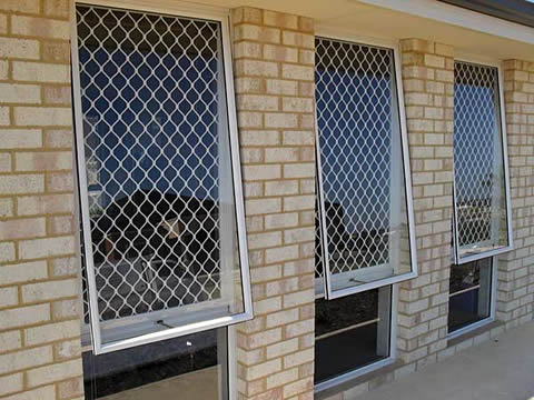 White coated aluminum diamond grills used for secure window guard.